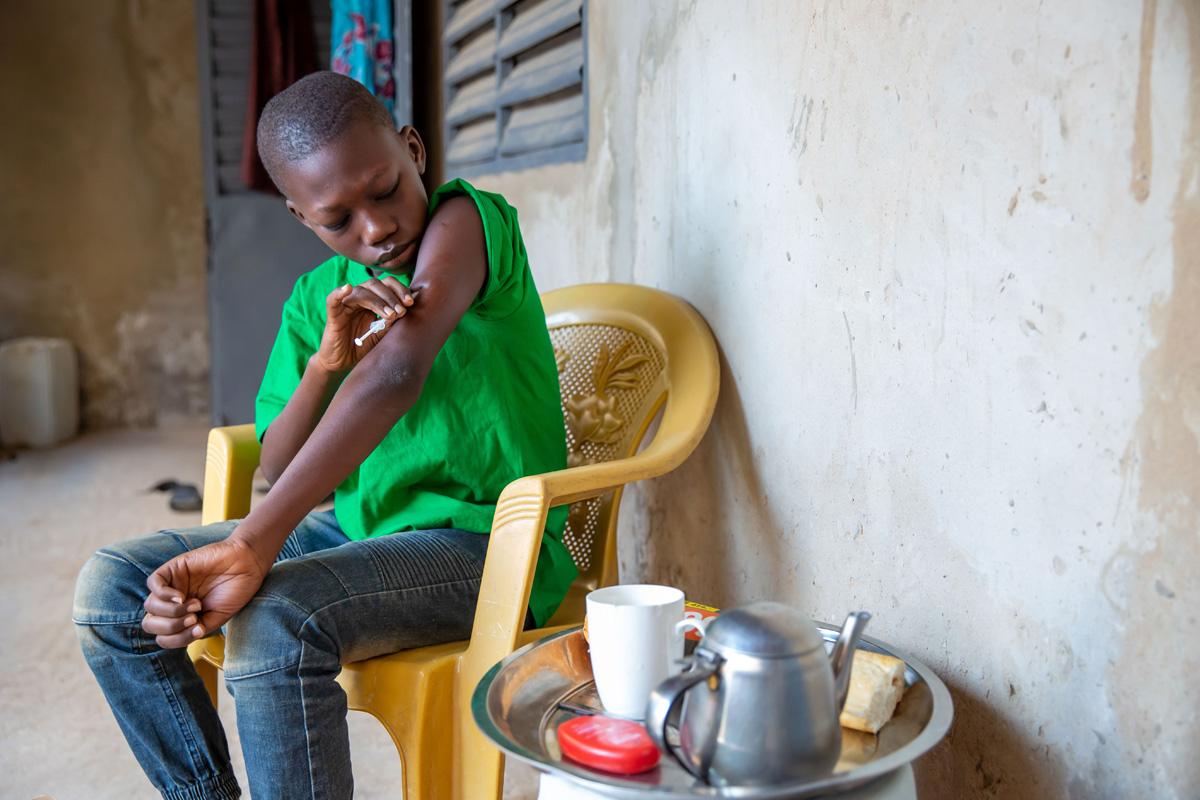 A boy managing his diabetes