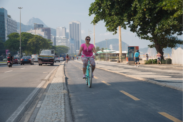 Woman cycling in Brazil. Photo by World Obesity Federation