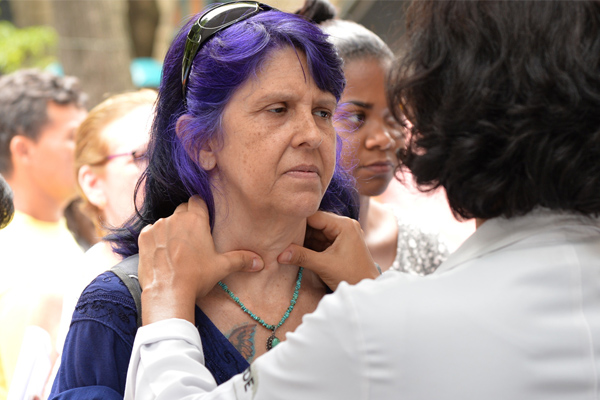 Woman getting her glands checked thyroid