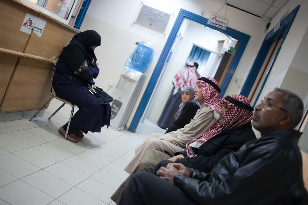 New registered patient Mohamed 64 years old from Damascus (front right of picture) is waiting for his medical consultation with MSF doctor after his first check up with MSF nurse. © N'gadi Ikram / Courtesy of MSF
