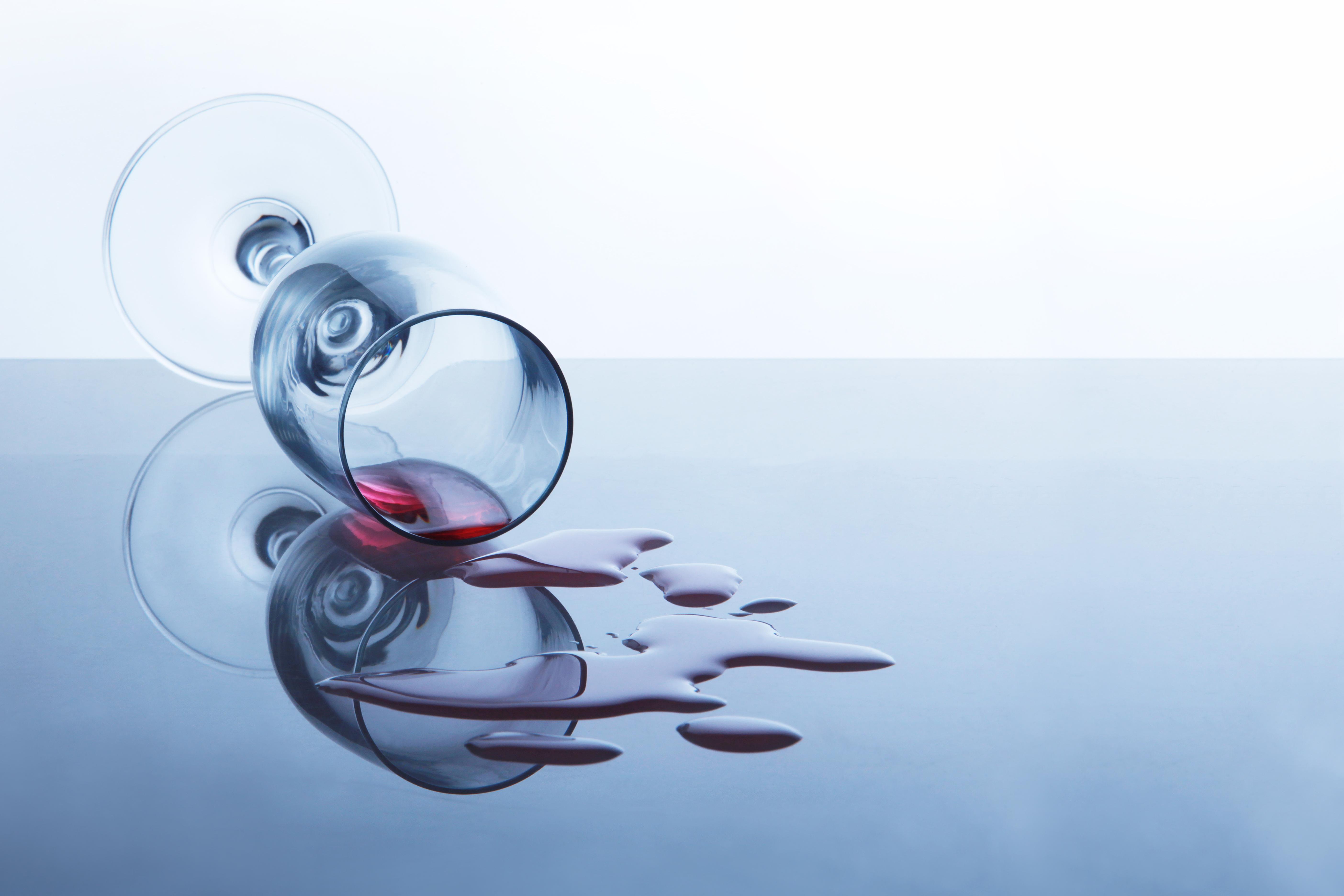 spilt glass of alcohol wine