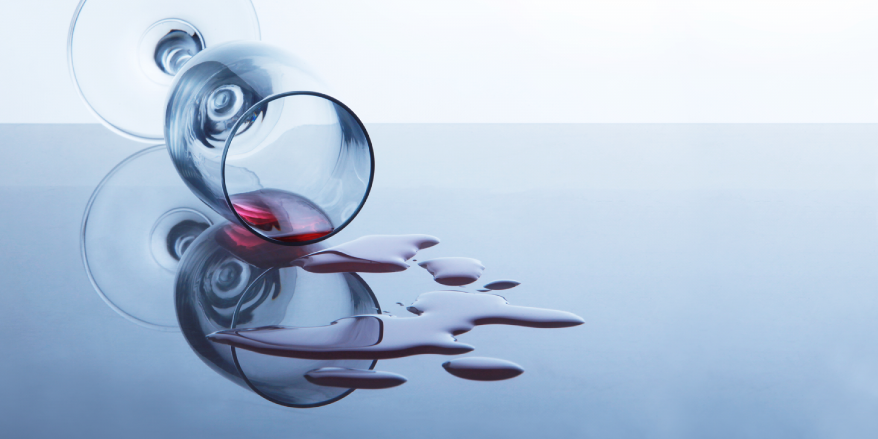 spilt glass of alcohol wine