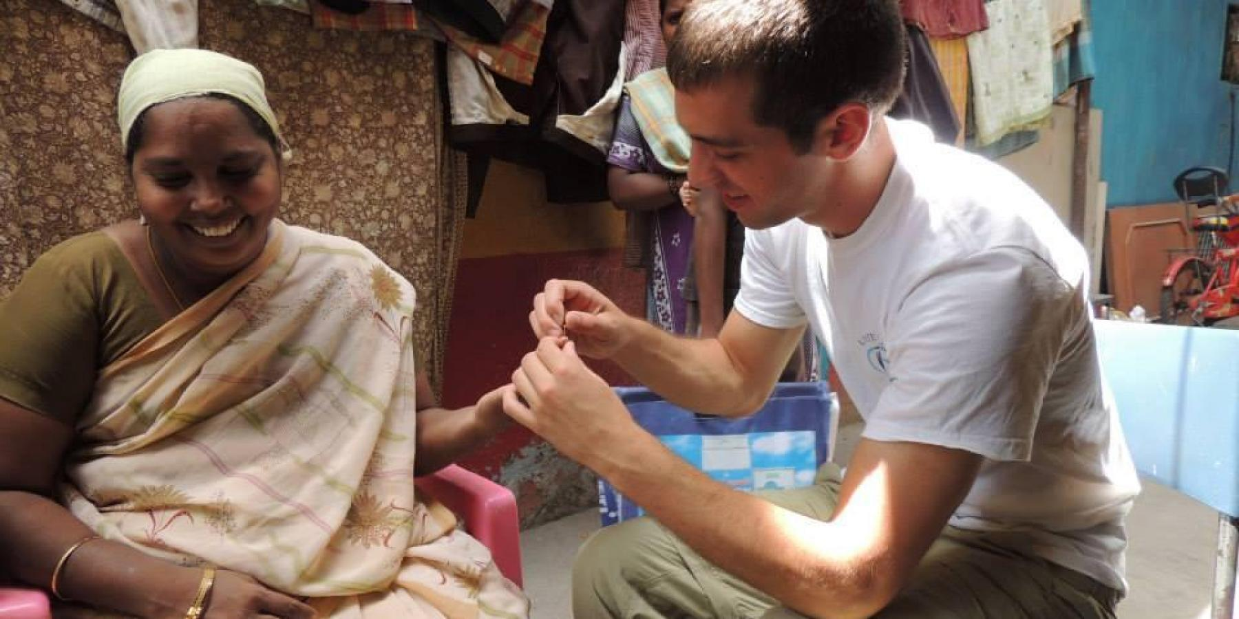 A medical student takes blood glucose levels at a mobile cataract clinic in Chennai, India