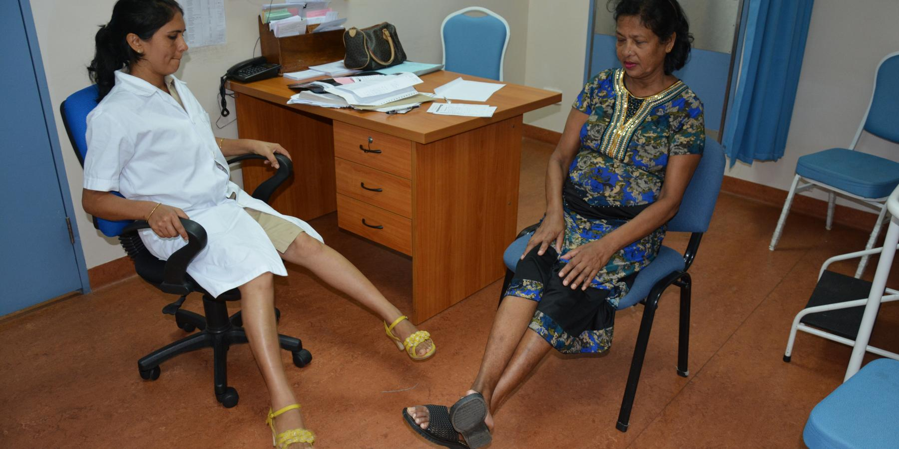 A Diabetic Specialist Nurse coaches a patient on simple lower limb exercises in Port Louis, Mauritius.