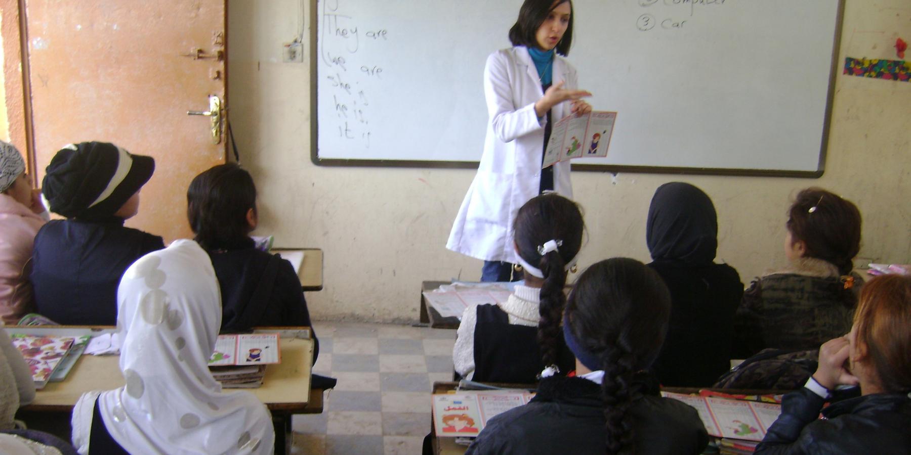Dr. Sarah Al-Obaydi leads a health education session at a school in rural Iraq.