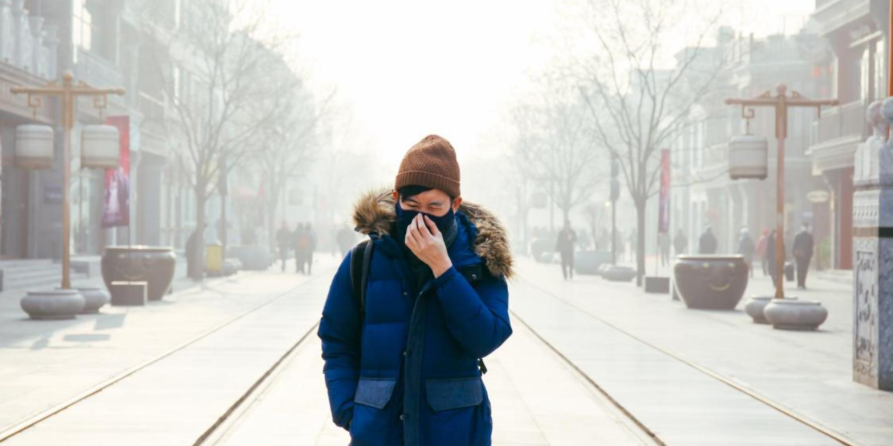 Man walking in Beijing air pollution
