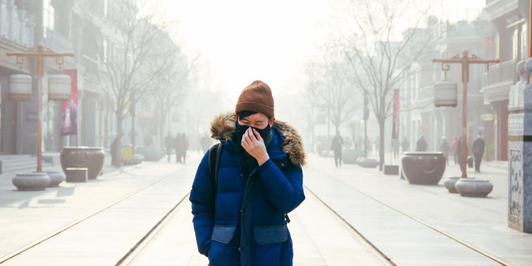 Man walking in Beijing air pollution