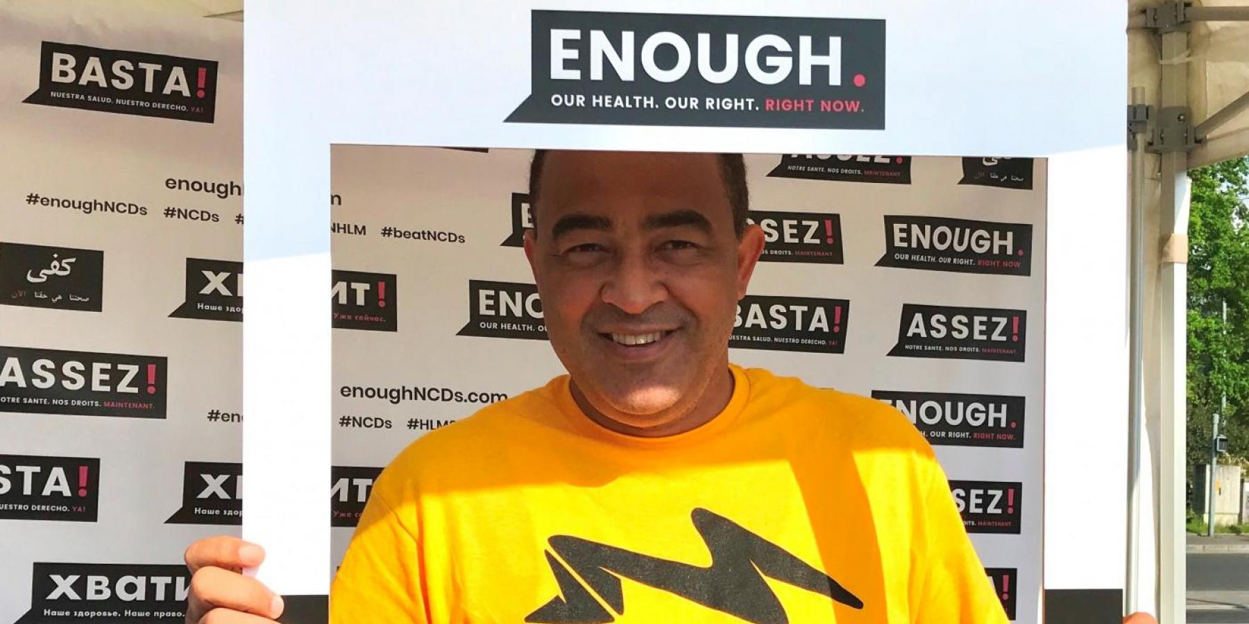 Jamaica's Minister of Health, Dr Christopher Tufton, framed by NCDA's Enough campaign at the WHO Walk the Talk event in Geneva, 20 May 2018