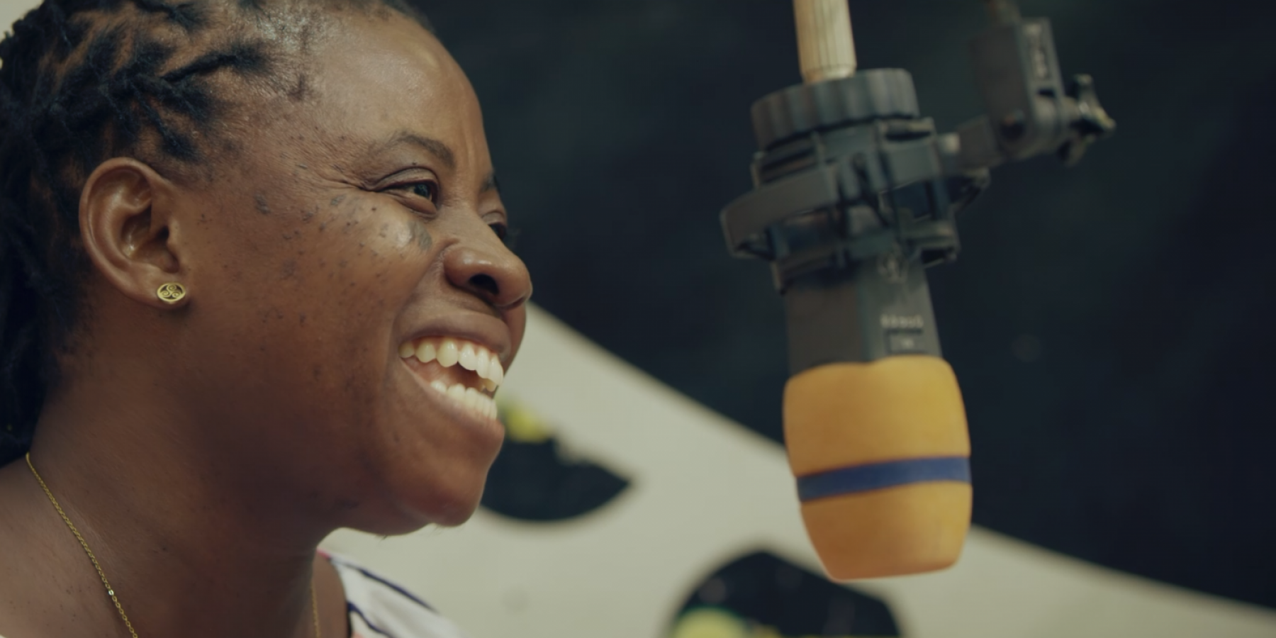 Martha Coffie, Vice President, Mental Health Society of Ghana. she speaks at a local radio station as part of the mini-film 'Stopping the Stigma'.