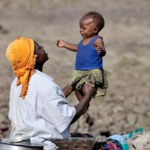 A woman displaced by fighting in the Democratic Republic of Congo in 2008, takes refuge and plays with her child © 2008 Paul Jeffrey, Courtesy of Photoshare