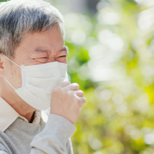 Man coughing. World TB Day