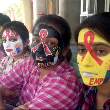 Students recognise International AIDS Candlelight Memorial Day with painted faces at the Centre for Social Work, Panjab University, Chandigarh, India.