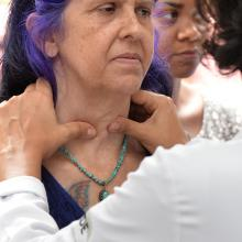 Woman getting her glands checked