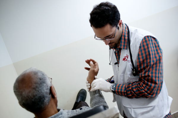 Mohamed 64 years old from Damascus during his medical consultation with MSF doctor. © N'gadi Ikram / Courtesy of MSF